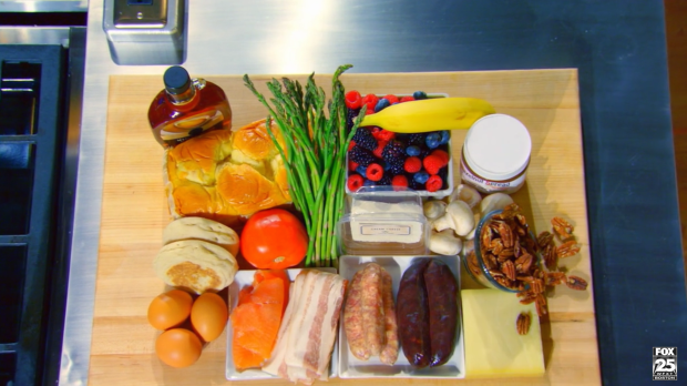 This box includes sausage, bacon, smoked salmon, eggs, tomato, asparagus, banana, berries, and English muffins.